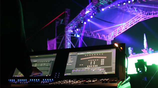 Lighting designer Evgeniy Toma using a Cobalt 20 console at Car-Fest 2014